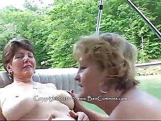 busty mature lesbians on a boat,,